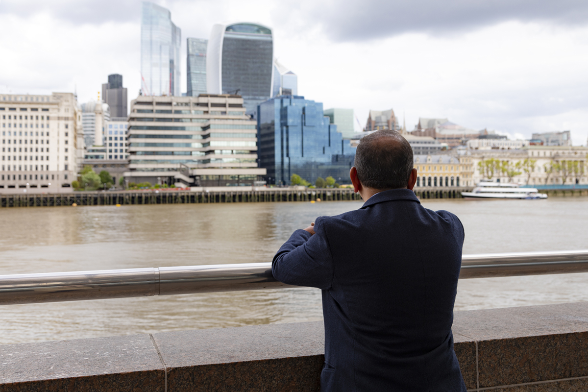 A man looking out across the river Thames.